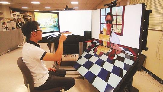 가상현실서 타인과 블록 놀이… 국내 연구진이 조작 기술 개발 기사의 사진