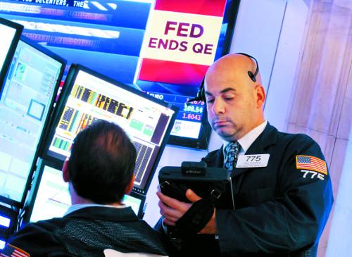 [2015 국제 10대 뉴스] (2) 美 Fed 9년 반 만에 금리 인상… 신흥국 성장 발목 기사의 사진