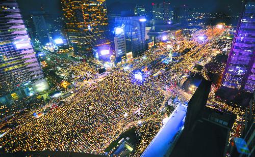 '1600만 촛불집회' 노벨 평화상 추진 기사의 사진