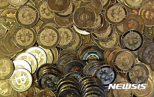 빗썸 접속장애… 가상화폐 투자자들 집단소송 준비 기사의 사진