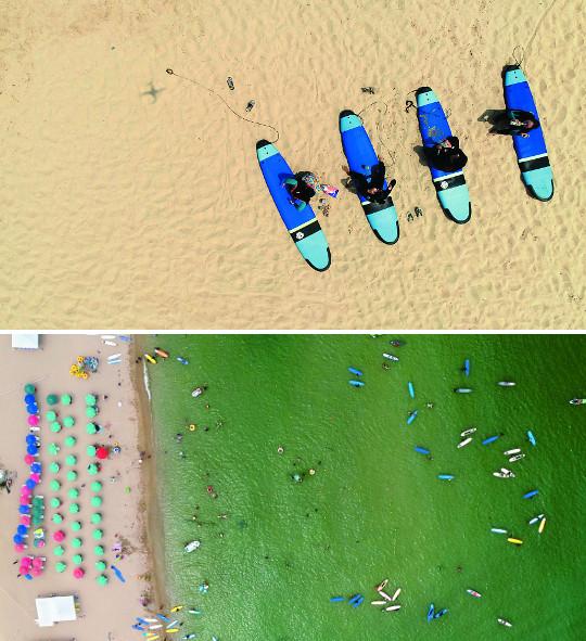 [앵글속 세상] 20만명이 즐긴다는 서핑, 짜릿한 파도에 몸을 맡기면, 이게 진정한 자유 기사의 사진